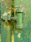Old copper turning green as it oxidises