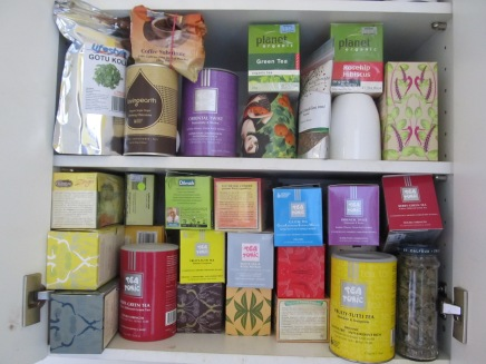 My herbal tea cupboard with some of the herbal teas we drink